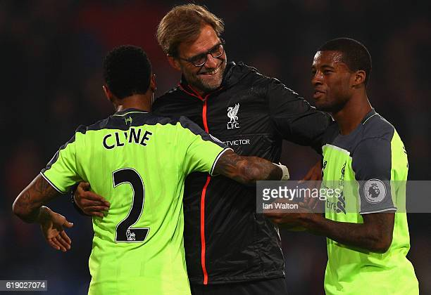 Jurgen Klopp Manager of Liverpool celebrates with his players following his teams win in the Premier League match between Crystal Palace and...