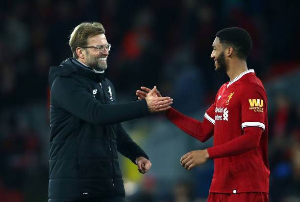 Jurgen Klopp, Manager of Liverpool celebrates with Joe Gomez of Liverpool after the Premier League match between Liverpool and Leicester City at...