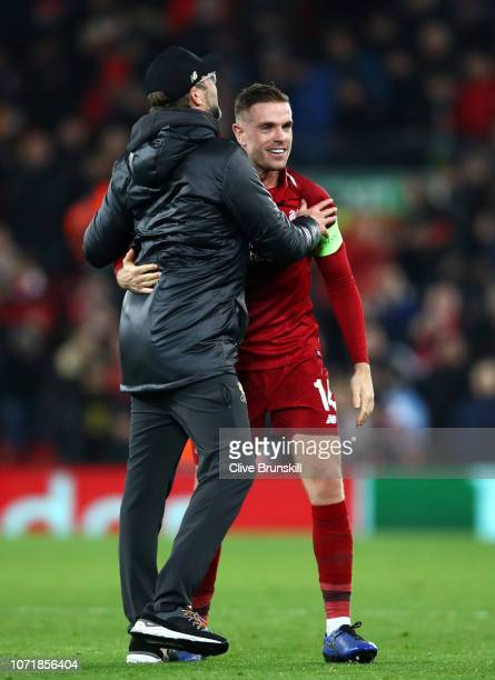 Jurgen Klopp Manager of Liverpool celebrates with Jordan Henderson of Liverpool after the UEFA Champions League Group C match between Liverpool and...