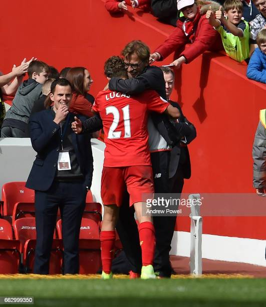 Jurgen Klopp manager of Liverpool celebrates with Lucas Leiva after the Premier League match between Liverpool and Everton at Anfield on April 1 2017...