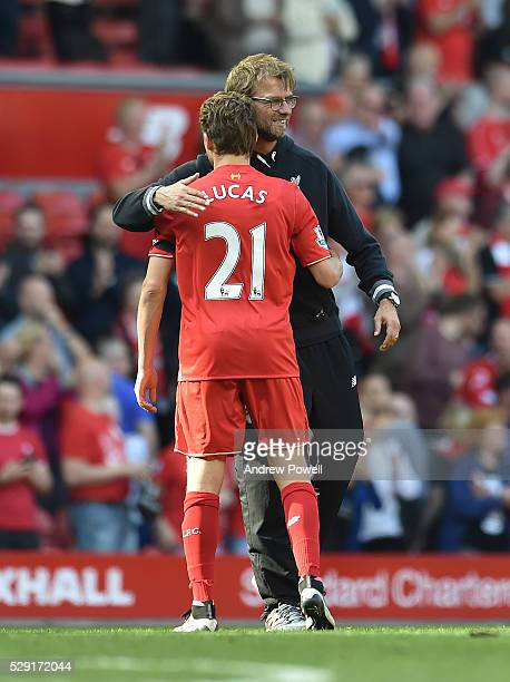 Jurgen Klopp manager of Liverpool celebrates with Lucas Leiva of Liverpool at the end of the Barclays Premier League match between Liverpool and...