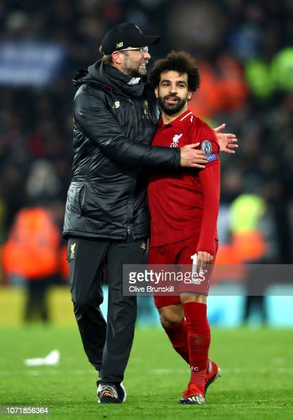 Jurgen Klopp Manager of Liverpool celebrates with Mohamed Salah of Liverpool after the UEFA Champions League Group C match between Liverpool and SSC...