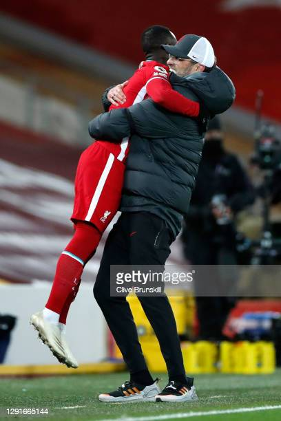 Jurgen Klopp, Manager of Liverpool celebrates with Naby Keita after the Premier League match between Liverpool and Tottenham Hotspur at Anfield on...