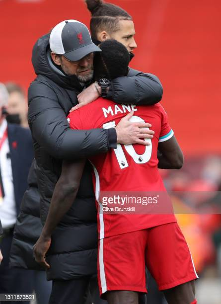 Jurgen Klopp, Manager of Liverpool celebrates with Sadio Mane following the Premier League match between Liverpool and Aston Villa at Anfield on...