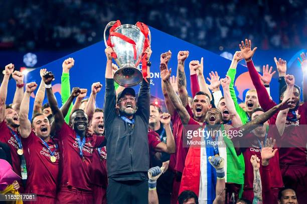 Jurgen Klopp, Manager of Liverpool celebrates with the Champions League Trophy after winning the UEFA Champions League Final between Tottenham...