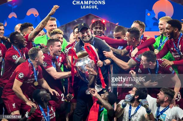 Jurgen Klopp Manager of Liverpool celebrates with the Champions League Trophy after winning the UEFA Champions League Final between Tottenham Hotspur...