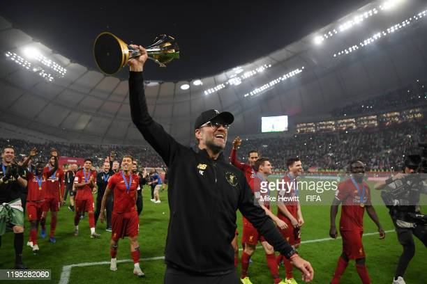 Jurgen Klopp, Manager of Liverpool celebrates with the FIFA Club World Cup Qatar 2019 trophy during a lap of honor following their victory in the...