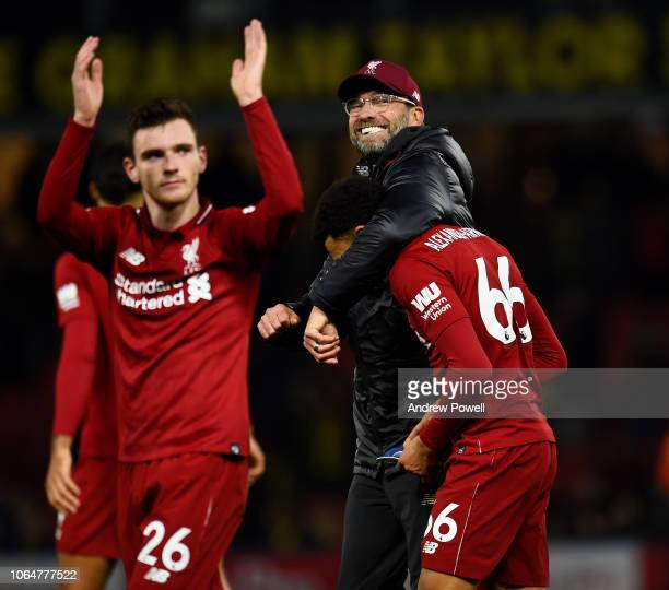 Jurgen Klopp manager of Liverpool celebrates with Trent AlexanderArnold of Liverpool at the end of the Premier League match between Watford FC and...