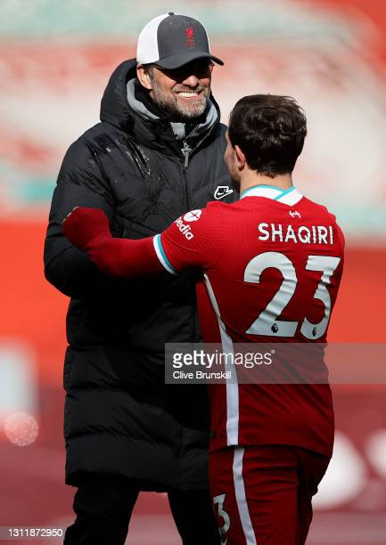 Jurgen Klopp, Manager of Liverpool celebrates with Xherdan Shaqiri following the Premier League match between Liverpool and Aston Villa at Anfield on...