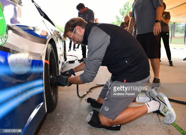Jurgen Klopp manager of Liverpool changing tyres during a tour of Roush Fenway Racing on July 21 2018 in Charlotte North Carolina