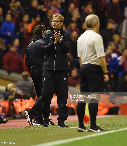 Jurgen Klopp manager of Liverpool claps to the fans at the end of the Capital One Cup Fourth Round match between Liverpool and AFC Bournemouth at...