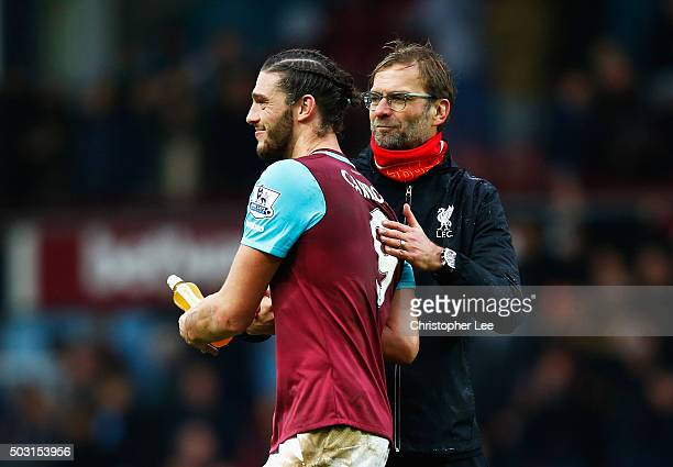 Jurgen Klopp manager of Liverpool congratulates Andy Carroll of West Ham United after the Barclays Premier League match between West Ham United and...