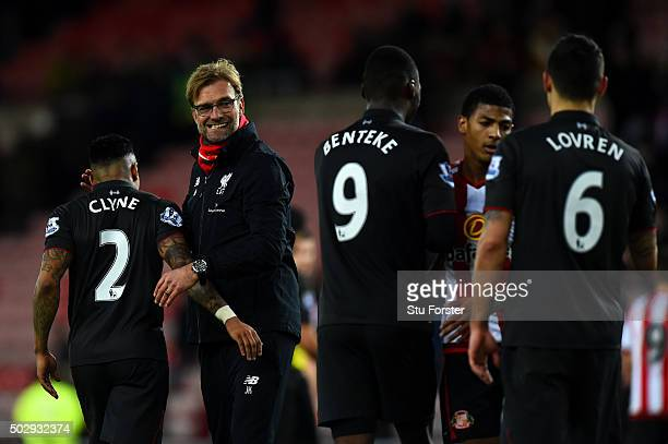 Jurgen Klopp manager of Liverpool congratulates his players after the Barclays Premier League match between Sunderland and Liverpool at Stadium of...