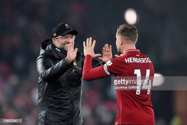 Jurgen Klopp Manager of Liverpool congratulates Jordan Henderson of Liverpool following the Premier League match between Liverpool FC and Crystal...