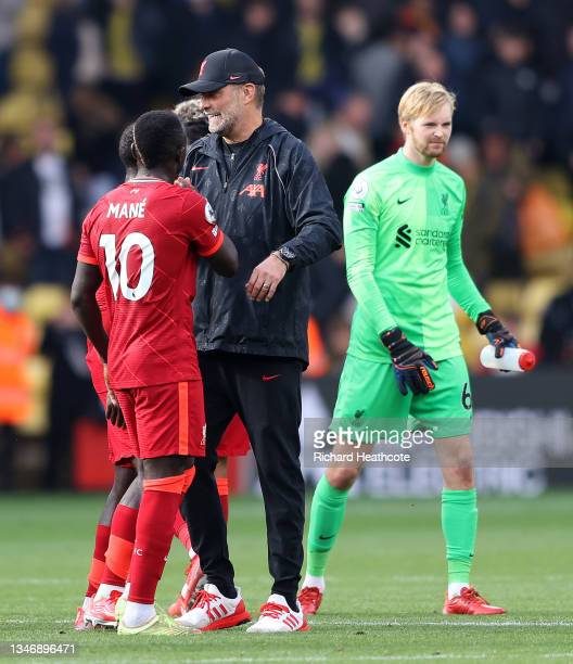 Jurgen Klopp, Manager of Liverpool congratulates Sadio Mane at the end of match during the Premier League match between Watford and Liverpool at...
