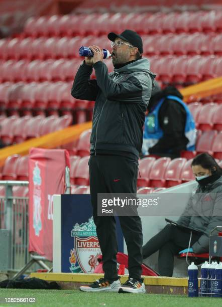 Jurgen Klopp Manager of Liverpool drinks during the UEFA Champions League Group D stage match between Liverpool FC and FC Midtjylland at Anfield on...