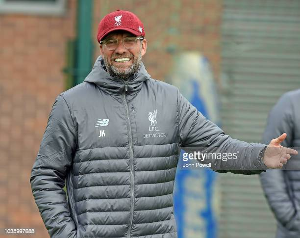 James Milner of Liverpool with John Achterberg first team goalkeeping coach of Liverpool during a training session at Melwood on September 19 2018 in...