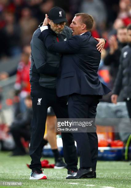 Jurgen Klopp Manager of Liverpool embraces Brendan Rodgers Manager of Leicester City after the Premier League match between Liverpool FC and...