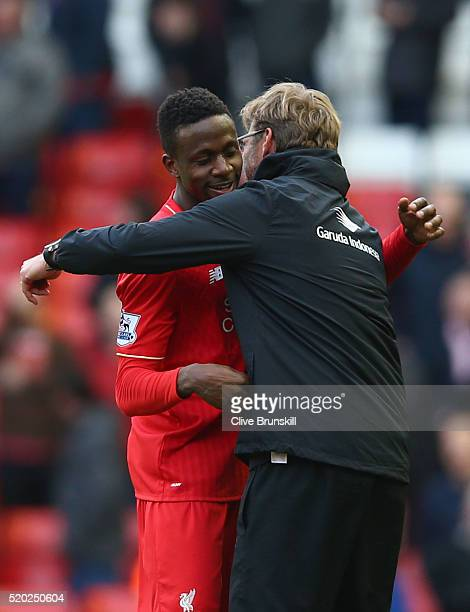 Jurgen Klopp manager of Liverpool embraces Divock Origi of Liverpool after the Barclays Premier League match between Liverpool and Stoke City at...