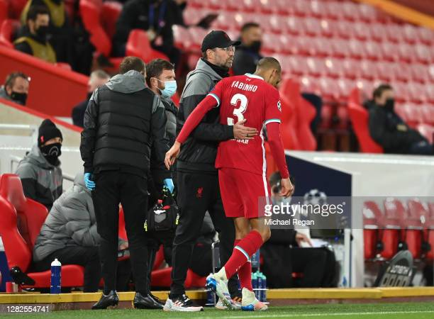 Jurgen Klopp, Manager of Liverpool embraces Fabinho of Liverpool after he sustains an injury during the UEFA Champions League Group D stage match...