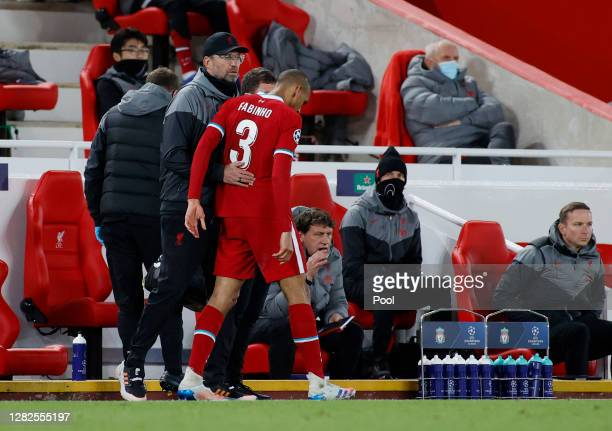 Jurgen Klopp Manager of Liverpool embraces Fabinho of Liverpool after he sustains an injury during the UEFA Champions League Group D stage match...