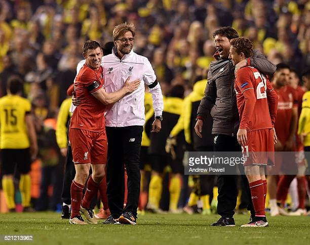 Jurgen Klopp manager of Liverpool embraces James Milner of Liverpool at the end of the UEFA Europa League Quarter Final Second Leg match between...