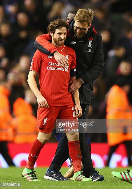 Jurgen Klopp manager of Liverpool embraces Joe Allen of Liverpool after the Emirates FA Cup Fourth Round match between Liverpool and West Ham United...