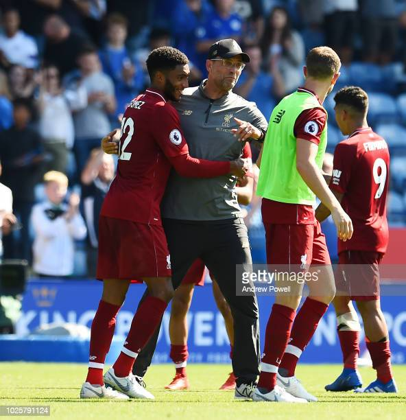 Jurgen Klopp manager of Liverpool embraces Joe Gomez at the end of the the Premier League match between Leicester City and Liverpool FC at The King...