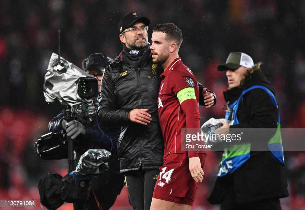 Jurgen Klopp Manager of Liverpool embraces Jordan Henderson of Liverpool after the UEFA Champions League Round of 16 First Leg match between...