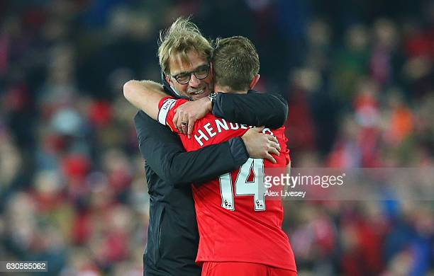 Jurgen Klopp manager of Liverpool embraces Jordan Henderson of Liverpool after the Premier League match between Liverpool and Stoke City at Anfield...