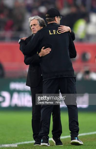 Jurgen Klopp Manager of Liverpool embraces Jorge Jesus Head Coach of CR Flamengo following at the final whistle of the FIFA Club World Cup Qatar 2019...
