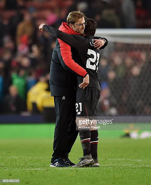 Jurgen Klopp manager of Liverpool embraces Lucas Leiva at the end of the Capital One Cup semi final first leg match between Stoke City and Liverpool...