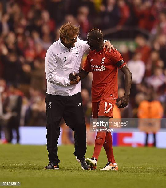 Jurgen Klopp manager of Liverpool embraces Mamadou Sakho of Liverpool at the end of the UEFA Europa League Quarter Final Second Leg match between...
