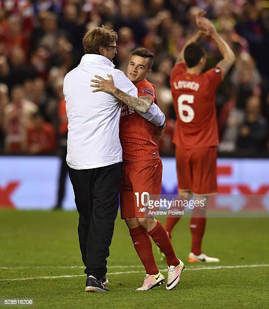 Jurgen Klopp manager of Liverpool embraces Philippe Coutinho at the end of the UEFA Europa League Semi Final Second Leg match between Liverpool and...