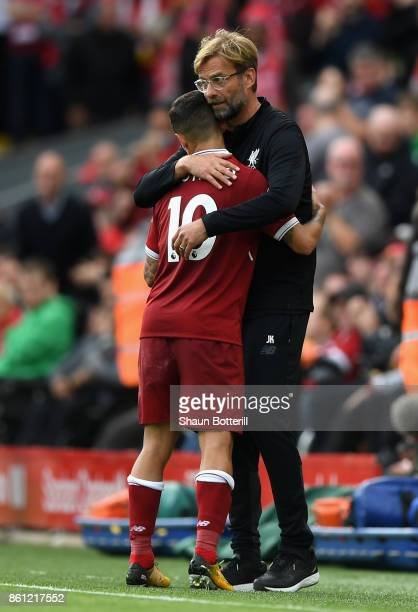 Jurgen Klopp Manager of Liverpool embraces Philippe Coutinho during the Premier League match between Liverpool and Manchester United at Anfield on...