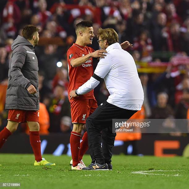 Jurgen Klopp manager of Liverpool embraces Philippe Coutinho of Liverpool at the end of the UEFA Europa League Quarter Final Second Leg match between...
