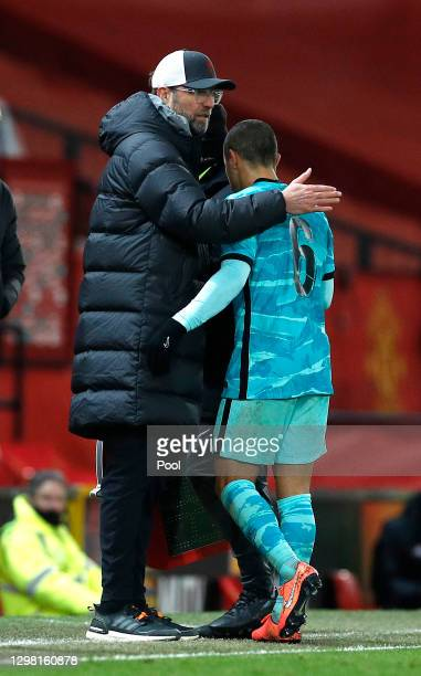 Jurgen Klopp, Manager of Liverpool embraces Thiago Alcantara of Liverpool as he is substituted during The Emirates FA Cup Fourth Round match between...