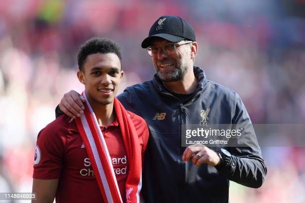 Jurgen Klopp Manager of Liverpool embraces Trent AlexanderArnold of Liverpool after the Premier League match between Liverpool FC and Wolverhampton...