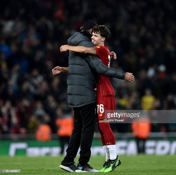 Jurgen Klopp manager of Liverpool embracing Neco Williams at the end of the Carabao Cup Round of 16 match between Liverpool FC and Arsenal FC at...