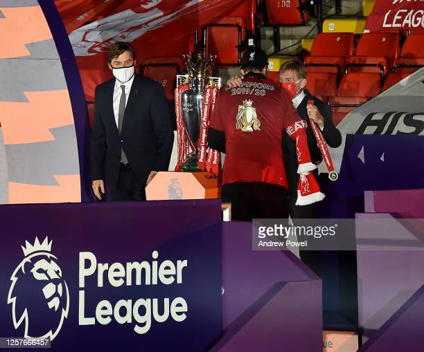 Jurgen Klopp manager of Liverpool embracing Sir Kenny Dalglish after winning the Premier League match between Liverpool FC and Chelsea FC at Anfield...