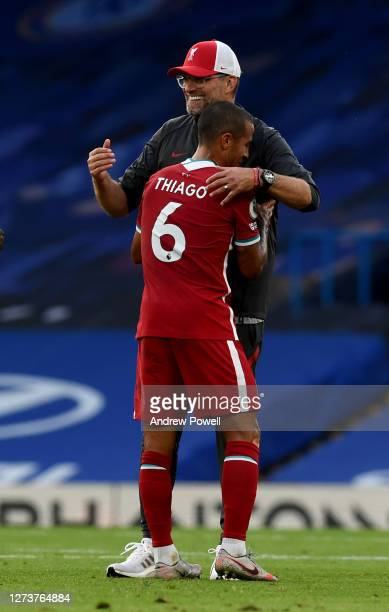 Jurgen Klopp manager of Liverpool embracing Thiago Alcantara of Liverpool at the end of the Premier League match between Chelsea and Liverpool at...