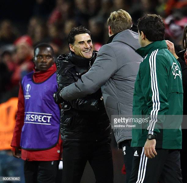 Jurgen Klopp manager of Liverpool embrases Didier Tholot manager of FC Sion at the end of the UEFA Europa League match between FC Sion and Liverpool...