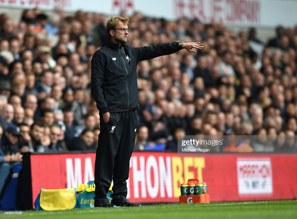 Jurgen Klopp, manager of Liverpool gestures during the Barclays Premier League match between Tottenham Hotspur and Liverpool at White Hart Lane on October 17, 2015 in London, England.