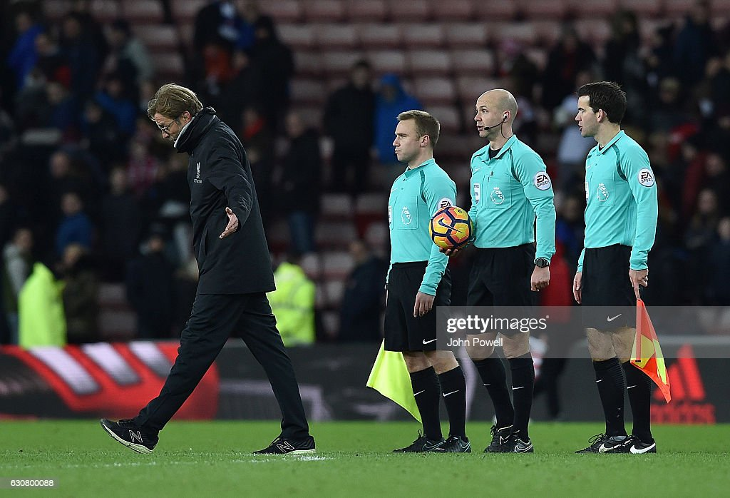 Jurgen Klopp Manager of Liverpool gestures with the referee at the end of the Premier League match between Sunderland and Liverpool at Stadium of Light on January 2, 2017 in Sunderland, England.
