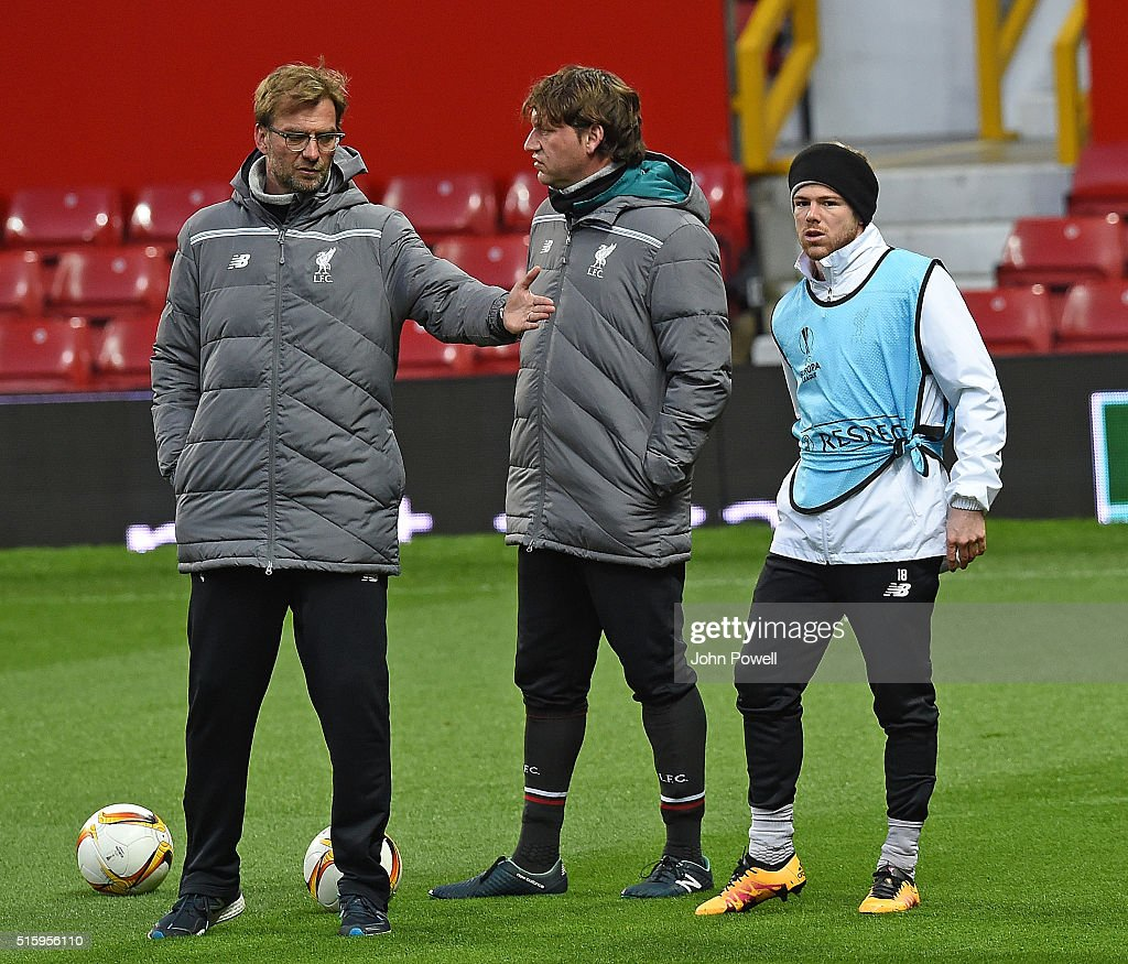 Jurgen Klopp Manager of Liverpool gives advice to Alberto Moreno of Liverpool during a training session at Old Trafford on March 16, 2016 in Liverpool, United Kingdom.