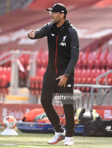 Jurgen Klopp Manager of Liverpool gives his team instructions during the Premier League match between Liverpool FC and Burnley FC at Anfield on July...