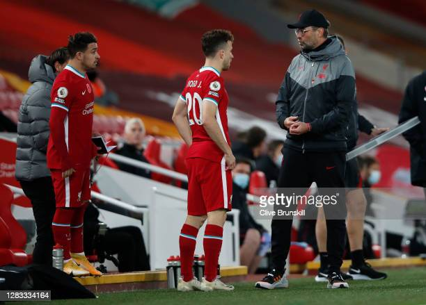 Jurgen Klopp, Manager of Liverpool gives instructions to his substitutes Diogo Jota and Xherdan Shaqiri ahead of them coming on during the Premier...