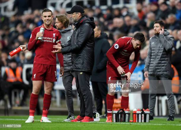 Jurgen Klopp Manager of Liverpool gives instructions to Jordan Henderson of Liverpool during the Premier League match between Newcastle United and...