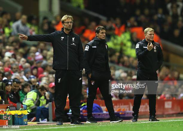 Jurgen Klopp manager of Liverpool gives instructions with Eddie Howe manager of Bournemouth during the Capital One Cup Fourth Round match between...