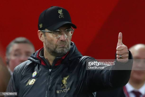Jurgen Klopp Manager of Liverpool gives the thumbs up to his players during the Premier League match between Liverpool FC and Everton FC at Anfield...